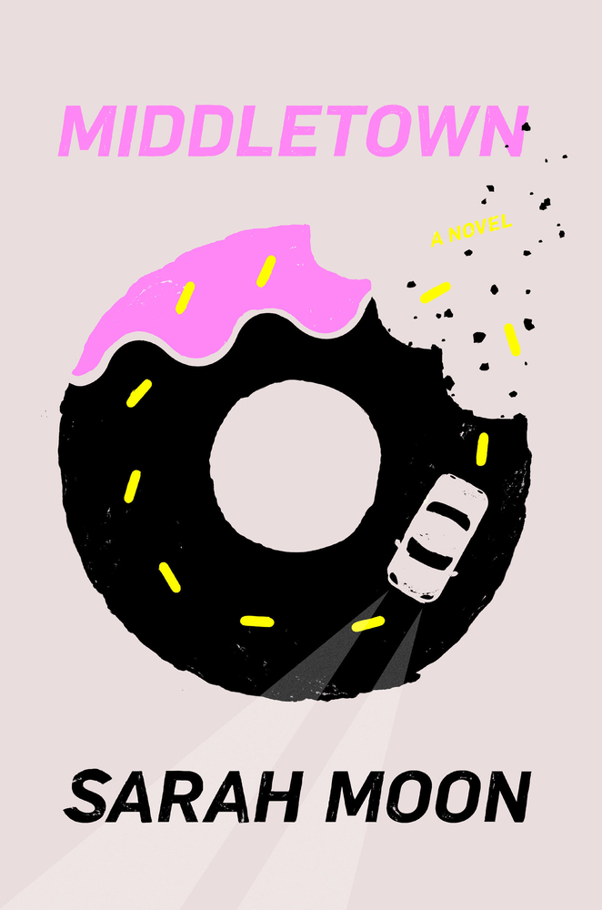Grey background and center-framed donut with a car driving inside of the donut.